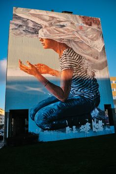"""""""Head In The Clouds"""" by Australian artist Fintan Magee in Estarreja (Aveiro)"""