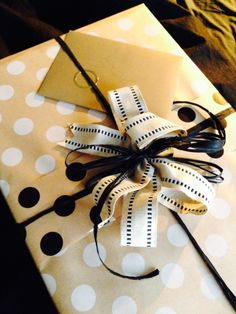 Birthday wrapping for Harry. Large dots Black & White on kraft and linen ribbon.