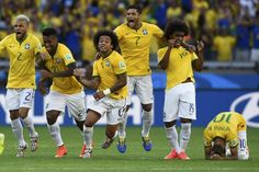 Brazil's national soccer players celebrate teammate Neymar's (R) decisive goal during a penalty shootout in their 2014 World Cup round of 16 game against Chile at the Mineirao stadium in Belo Horizonte June 28, 2014. Also pictured are (L-R) Brazil's Dani Alves, Jo,Marcelo, Hulk and Willian. REUTERS/Dylan Martinez