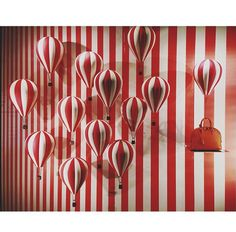 LV window display- Love the play with stripes, but I would have subbed in a bag with greater hie contrast (a yellow green or blue shade)