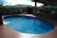 deck build directly on top of pool coping. Oval Swimming Pool, Small Inground Pool, Swimming Pool Designs, Intex Pool, Above Ground Pool Decks, Above Ground Swimming Pools, In Ground Pools, Backyard Pool Landscaping, Small Backyard Pools