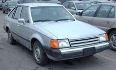 """1988 Ford Escort GL. Car #3. Stepdad and grandpa went to the auction to buy me a car. They asked what I wanted, I said anything but a ford escort....they didn't hear the """"anything but"""":p."""