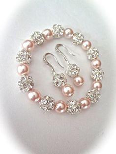 Conjunto pulsera y pendientes de perlas  por QueenMeJewelryLLC