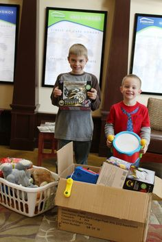 ANOTHER CHRISTMAS -- Brothers Dylan (left) and Peyton Bingham display some of the Christmas presents they donated to the kids at Northwest Arkansas Children's Shelter. Their mom, Alicia, was beaming with pride as her youngsters generously passed the gifts on to our kiddos. THANKS to the Bingham family for having such giving hearts!