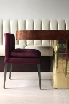 the most gorgeous velvet plum chair with a statement dining table