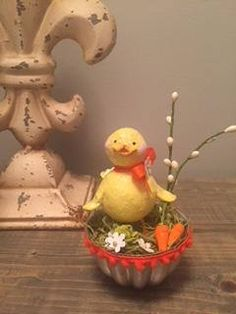 This handcrafted paper clay spring chick sits in a vintage jello mold. It measures 4 tall.
