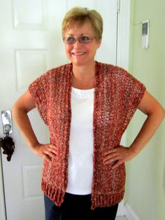 This vest/sweater/shrug is worked in two long strips that are then seamed together at the back and sides. The easy half-double crochet stitch drapes beautifully when worked with an L hook. Bottom ribbing is optional.
