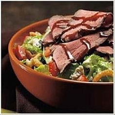 This salad contain seared top sirloin, romaine, frizzled onions, tomatoes & gorgonzola, all tossed with blue cheese vinaigr...