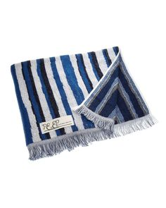 a blue and navy stripe towel by Via Bus Stop