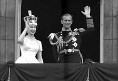1953: Queen Elizabeth II and Prince Philip wave to supporters from the balcony at Buckingh...