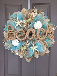 "This wreath measures approximately 24x24x7 and will be shipped in a large box to keep it from getting damaged - however it will probably need some ""floofing"" (very technical word) once it reaches it's final destination (just fluff out the mesh and straighten any ribbon that has gotten bent). Includes two starfish and two sand dollars. These wreaths are for indoors or out but best on a porch with some kind of overhang so it's not getting constantly drenched by rain."