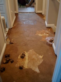 brown paper mache floor.  what a great idea for an inexpensive flooring fix.