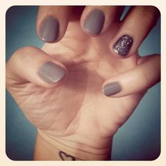 Grey Glitter Nails. Two coats of RGB Steel, two coats of Martha Stewart Glitter Glue in Hematite on ring fingers, two coats of Chanel Extreme Shine.