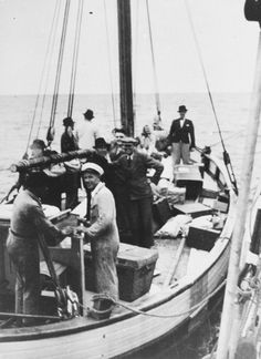 """Danish fishermen (foreground) ferry a boatload of fugitives across a narrow sound to neutral Sweden.  Within just a few weeks of the first arrests by the Germans in 1943, some 7,000 Danish Jews managed to make their way to the safety of fishing boats that plied this route."""