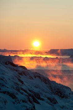 Greenland sunrise  (photo by Andre Schoenherr)