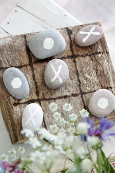 Tic-tac-toe made from stones and driftwood.