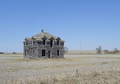 In the middle of cultivated fields in Nebraska there will be gray wood skeletons of big farm houses.    They seem so sad.