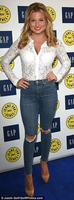 Ripped: Zara Holland showed off her stunning figure in a pair of tight ripped jeans as she...