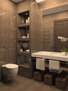 Modern bathroom with tiled brown walls and a large white basin