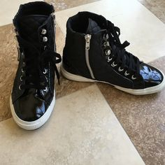 Hightop quilted and pleather Supergas Hightop Supergas only worn one time - I do not have original tags but they are like new and in great condition. sides are quilted, one side has a zipper, toes and heel are pleather. Super cute! Superga Shoes Sneakers