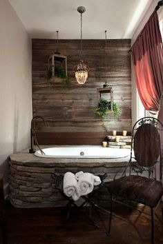 Rustic bathroom design with raw wood wall, stone tub, & drop lighting Stone Tub, Wood Stone, Rustic Stone, Rustic Wood, Rustic Feel, Rustic Decor, Weathered Wood, Rustic Modern, Rustic Charm