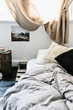 Linen bedding, knit pillows, low artwork - pretty darn glorious