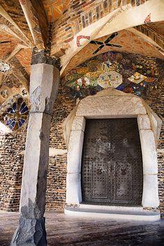 Entrance to the crypt. The Church of Colònia Güell (unfinished)  Santa Coloma de Cervelló, (near Barcelona) Spain. Construction started: 1898. Antoni Gaudi.