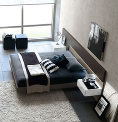 Floating Bed Design in Various Models: Gorgeous Modern Bedroom In Black And White With Beautiful Floating Bed Equipped With White Rug Design...