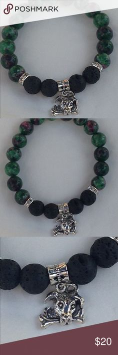 "Ruby Zoisite Puppy Dog Bracelet This lovely bracelet is made with natural ruby zoisite and black lava rocks. It features rhinestone studded accents and a cute silver tone puppy charm. This piece is on elastic and will stretch to fit up to an 8"" wrist.    Lava rocks can be used as oil diffusers! Add one drop of oil to each of the lava rocks. The effect will last for a couple of days.   All PeaceFrog jewelry items are handmade by me! Take a look through my boutique for more unique creations…"