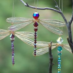 Beaded dragonfly sun catchers  Possible DIY with dryer sheets for the wings?