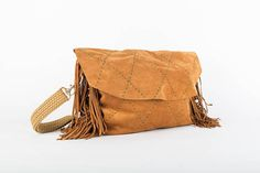 This everyday carry all bag comes in a beautiful soft suede and slouchy camel brown leather, paired with dark green hand embroidery, 16 cm fringed margins, an interior phone pocket and a nicely hand braided adjustable strap, which can easily carry a 15'' laptop and more. Height: 31 cm/ 12.2 inch  Width: 37 cm bottom, 41 cm top/ 14.5 inch bottom/16.2 inch top  Deep: 4 cm/ 1.6 inch  Adjustable strap: 117 cm/ 46 inch This bag is exclusively handcrafted. The leather is ma... Carry All Bag, Everyday Carry, Soft Suede, Leather Craft, Hand Embroidery, Camel, Brown Leather, Pairs, Trending Outfits