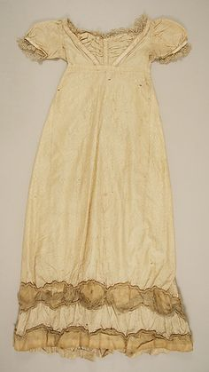 1804–14 ca. Pale Gold Dress, Probably British. Silk, Empire line, short puffed sleeves, neckline insert under V-neck, trimmed hem and sleeves. metmuseum.org Credit: Gift of Mrs. Charles Rand Kennedy, 1946.