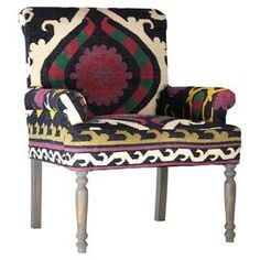"""Indulge in a splash of exotic style with this arm chair, featuring ikat upholstery, spooled legs, and a mango wood frame.  Product: ChairConstruction Material: Mango woodColor: MultiDimensions: 35"""" H x 31"""" W x 30"""" D"""