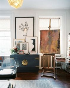 A painting on an easel is surrounded by Lucite furniture and art in a cozy West Village apartment | Home | Interiors | The Lifestyle Edit