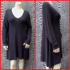Eileen Fisher knit dress tunic shark bite hem Uneven hem in blue shade.  Long sleeves.  Good condition.  No snagging or damage.  Feels like a big small, I usually wear an extra small and this one is just a bit big rather than a lot big. Eileen Fisher Sweaters