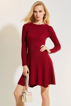 A knit skater dress featuring long sleeves and round neckline. Sleeve Length: Full Silhouette: A-Line Material: Polyester Blend Length: Above Knee, Mini Necklin