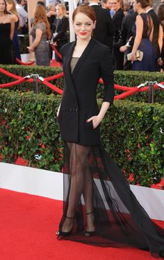 Emma Stone steps out in a Dior Couture oversizeblack tux and sheerskirt at the Screen Actors Guild Awards on January 25, 2015.