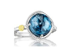 Like the heart of the deep ocean, this mystical navy blue beauty is mesmerizing. The London Blue Topaz gemstone is encased within silver prongs and placed on a beautiful crescent silver band, to create a true masterpiece. Wear this ring as part of a stackable set or on its own with any outfit to create a timeless sophisticated look.