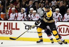 03.29.12 - Zdeno Chara takes the puck away from Alex Ovechkin. (Photo by Elsa/Getty Images) Never get sick of this!