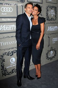Halle Berry attended Variety's 4th Annual Power of Women Event, at the Beverly Wilshire Four Seasons Hotel in Los Angeles, with her fiancé Olivier Martinez, where she she was honored for her work with The Jenesse Center, which promotes awareness about domestic abuse. Olivier Martinez wore a dark navy suit and a pale blue short and Halle Berry chose a dark navy/black tight fitted knee-length belted Roland Mouret dress.They look great together, don't they?