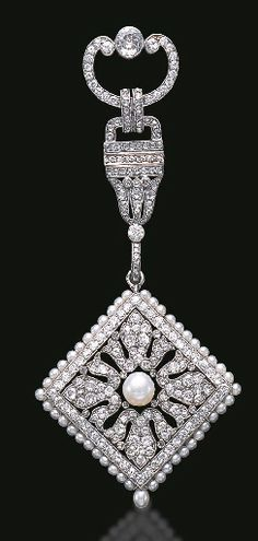 AN EXQUISITE BELLE EPOQUE DIAMOND AND PEARL LAPEL WATCH, BY CARTIER    circa 1910