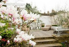I love the muted colours in this rooftop garden / terrace from interior locations company 1st Option