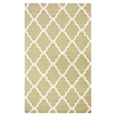 Hand-hooked wool rug with a light green Moroccan trellis motif.  Product: RugConstruction Material: Wool