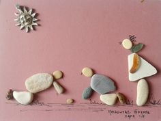 """ playing marbles"" pebble art by Hara"