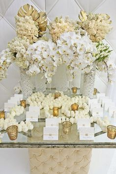 Gold and white floral arrangement #escortcard #wedding #reception #goldwedding #weddingdecor