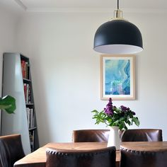 The Easiest Way to Style A Dining Room With Lighting, Art & Timeless Furniture