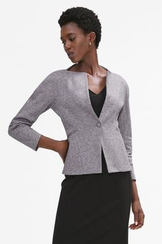 "This '40s-inspired take on the traditional blazer says, ""It's my turn."" In lieu of a traditional lapel, a square neckline frames the collarbone, and rounded seams at the sleeve allow for plenty of room through the arms."