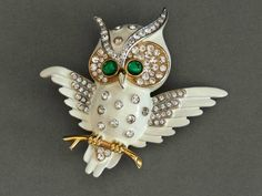 beautiful trifari 1960s white enamel golden owl brooch with clear rhinestones and emerald glass cabochons