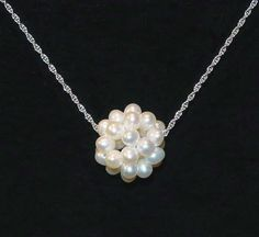 The Original Mississippi Snowball Necklace was created in 1999 by Lights Jewelers & Gemologists.  It is available in white or yellow gold, in three basic chain weights, and in 16, 18, 20 and 24 inch lengths.