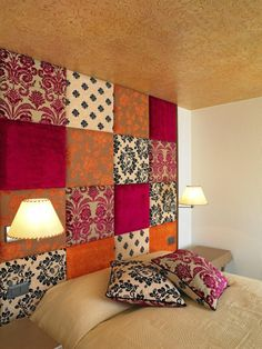 Padded Headboard Wall:    Cut plywood squares to your desired size(s).     Upholster them in your desired fabrics with batting underneath.     Attach to wall above your bed. Or cover your entire wall.     Add a few pillows using same fabrics to match! Lovely!